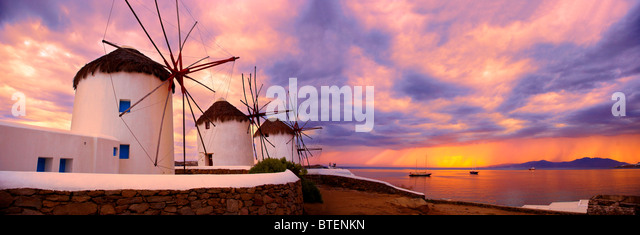 Sunset over the traditional Greek windmills of Mykonos Chora. Cyclades Islands, Greece - Stock Image