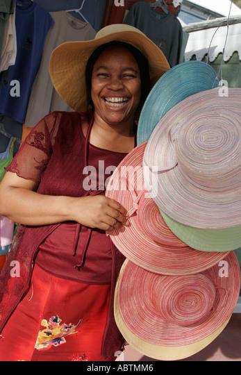 Sint Maarten Philipsburg Dutch duty free shopping souvenirs Black female hats - Stock Image