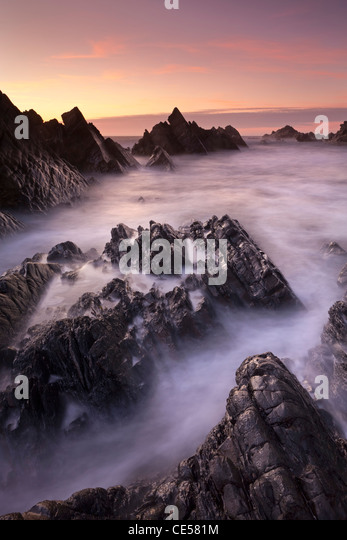 Broken rock ledges at Hartland Quay at sunset, North Devon, England. Winter (January) 2012. - Stock Image
