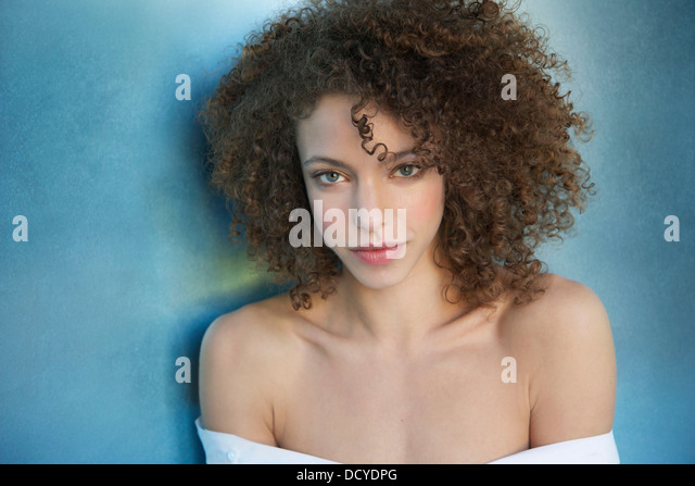 Portrait of Young Woman with Curly Hair - Stock Image