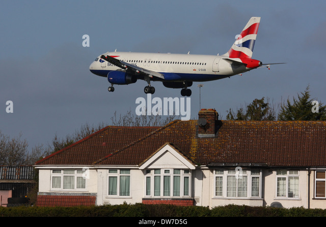 PLANE OVER HOUSE HEATHROW - Stock Image