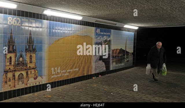Motherwell Town Centre Underpass at night,Lanarkshire,Scotland,UK with shopper - Stock Image