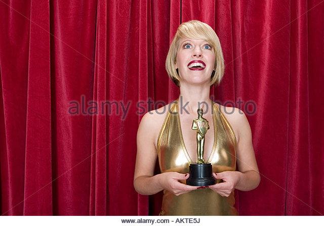 Actress holding an award - Stock-Bilder