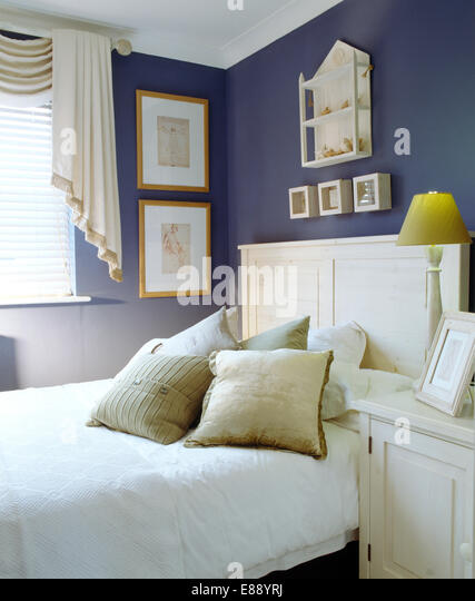 Shelf Above Bed In White Stock Photos Shelf Above Bed In
