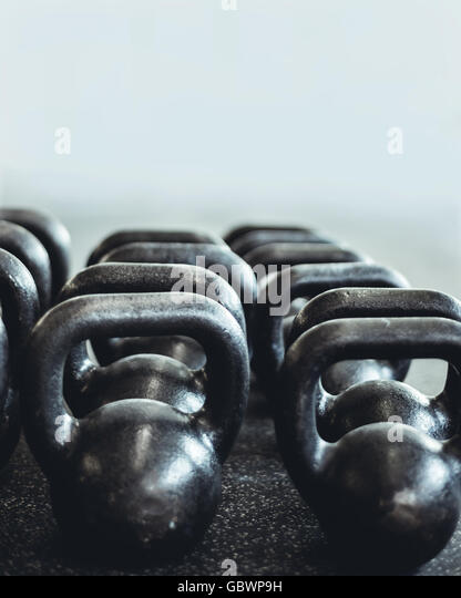 Closeup abstract photograph of kettlebells in the gym. - Stock Image