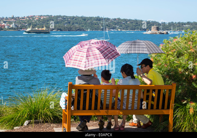 Sydney Australia NSW New South Wales Royal Botanic Gardens Asian man woman family Sydney Harbour harbor Parramatta - Stock Image