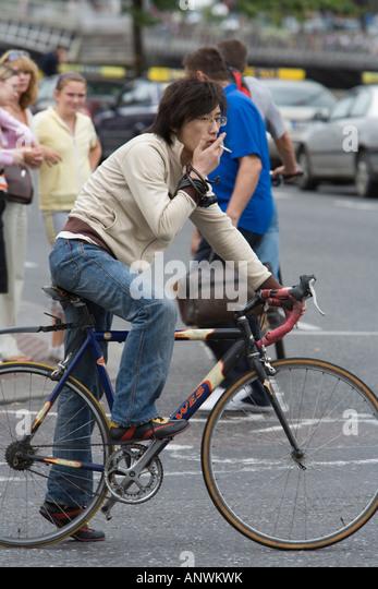 Smoking While Cycling Stock Photos & Smoking While Cycling ...
