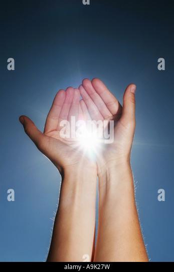 hands holding the sun - Stock-Bilder