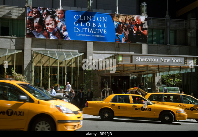 A sign announcing the Clinton Global Initiative at the Sheraton New York - Stock Image