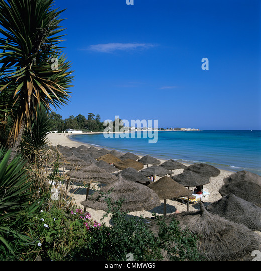 View along beach to the medina from the Sindbad Hotel, Hammamet, Cap Bon, Tunisia, North Africa, Africa - Stock Image
