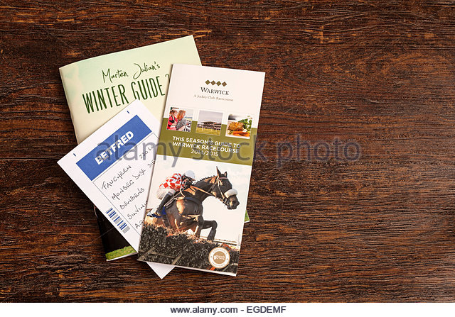 Horse racing booklets and filled in betting slip - Stock Image