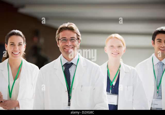 Portrait of smiling doctors - Stock Image