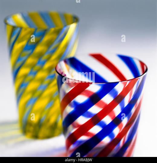 Striped tumblers. - Stock Image