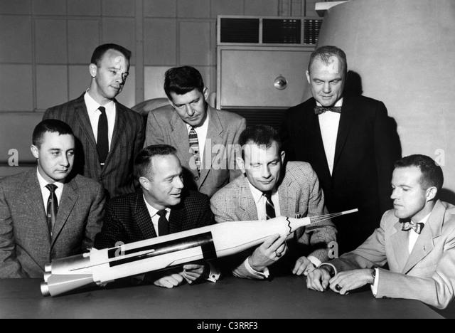 Original 7 Mercury Astronauts Inspect Mercury Model - Stock Image