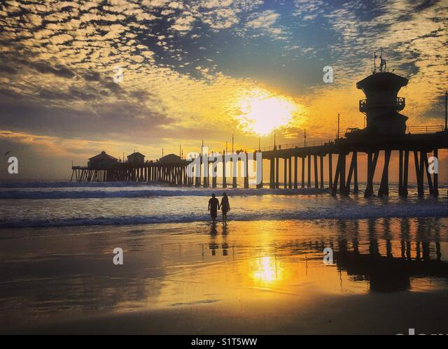 Setting Sun at the Pier - Stock Image