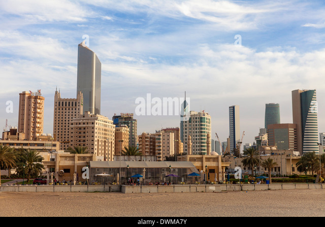 Looking towards city center buildings from a beach on Arabian Gulf Street, Sharq, Kuwait City, Kuwait, Middle East - Stock Image