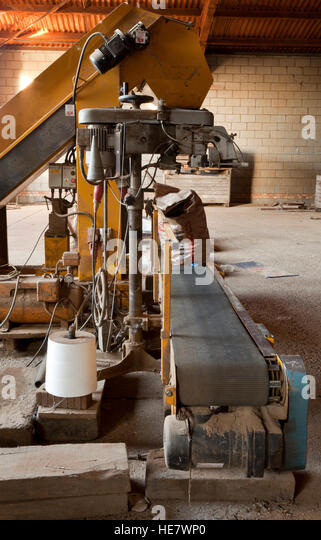 An agricultural potato bagging and stitching machine - Stock Image
