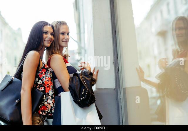 Beautiful women shopping spree on street - Stock Image