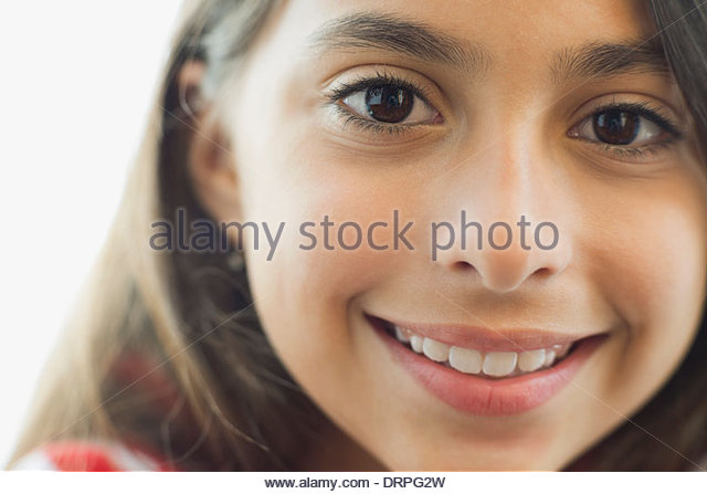 Close-up portrait of girl smiling - Stock Image