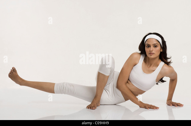 Woman practicing yoga - Stock-Bilder