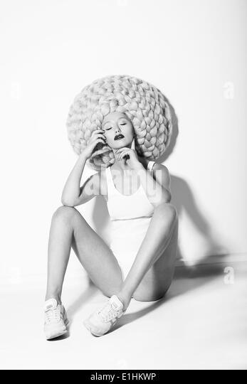 Art. Quaint Fancy Fashion Model sitting in Glamorous High Peruke - Stock Image