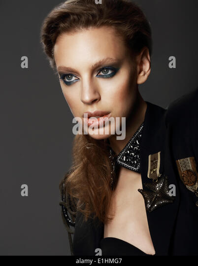 Honor. Portrait of Classy Woman in Military Uniform with Brooches - Stock Image
