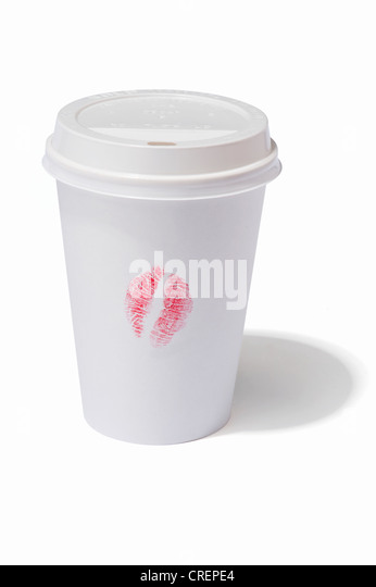A takeaway drink cup with a lipstick kiss print on the side - Stock Image