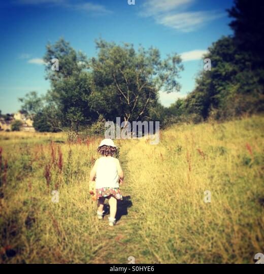 Little girl exploring - Stock-Bilder