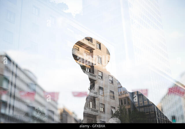 Double exposure of young afro black man outdoor in the city - Stock Image