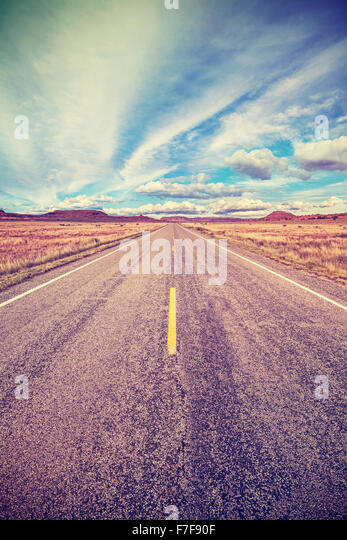 Retro stylized desert highway, travel adventure concept, USA. - Stock-Bilder