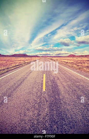 Retro stylized desert highway, travel adventure concept, USA. - Stock Image