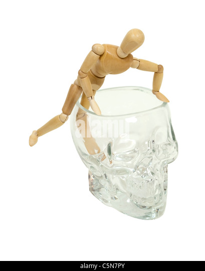 Ideas coming to mind shown by a model climbing out of the mind of a heavy crystal skull - path included - Stock Image