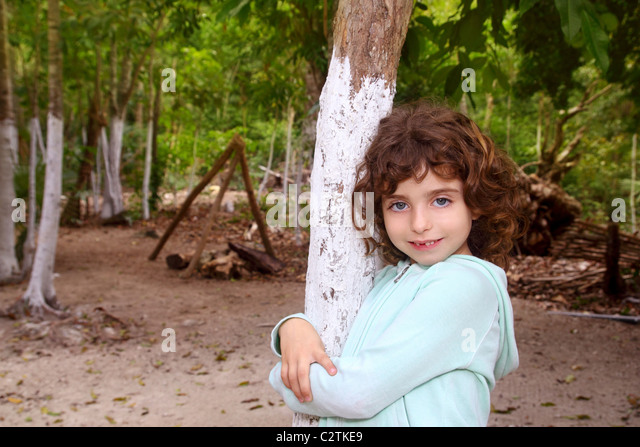 Little tourist girl posing in Mayan Riviera Jungle Mexico - Stock Image