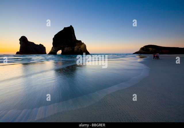 Sea stacks on Wharariki Beach Nelson North Island New Zealand - Stock-Bilder