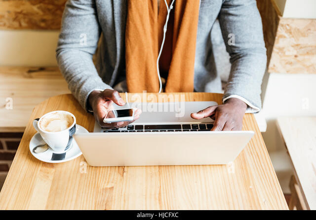 Businessman using his laptop in the Coffee Shop. Business Concept. - Stock Image