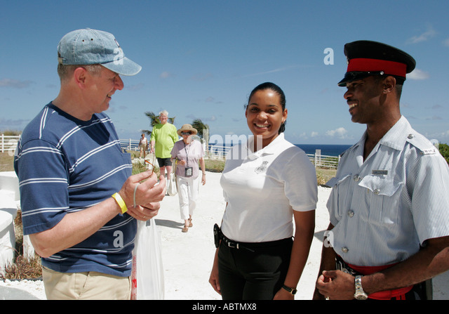 Turks and Caicos Grand Turk Lighthouse built 1852 North East Point Black male female police help tourist - Stock Image