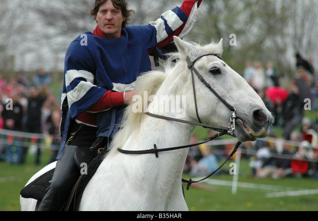Squire riding white horse at event - Stock Image
