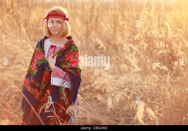 Portrait of young woman wearing traditional shawl - Stock Image