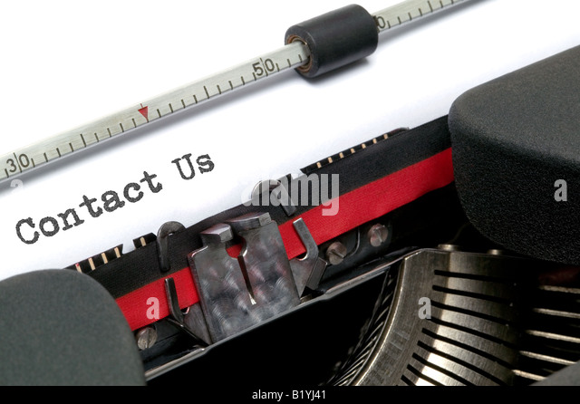 Contact Us typed on an old typewriter shot at an angle - Stock Image