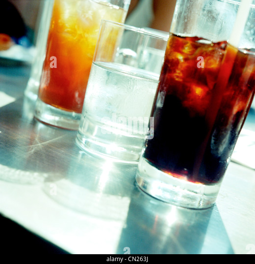 Soft drinks in glasses - Stock Image