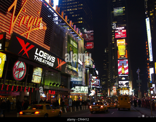 A line of taxis at Times Square at night - Stock Image