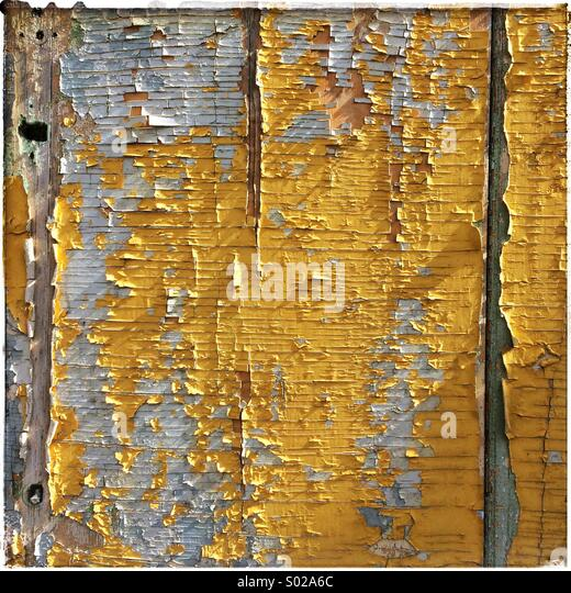 Wooden panel with peeling paint for background - Stock Image