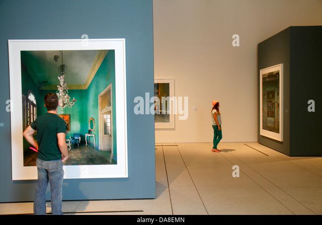 Tampa Florida Tampa Museum of Art gallery inside looking appreciating photographs teen boy girl - Stock Image