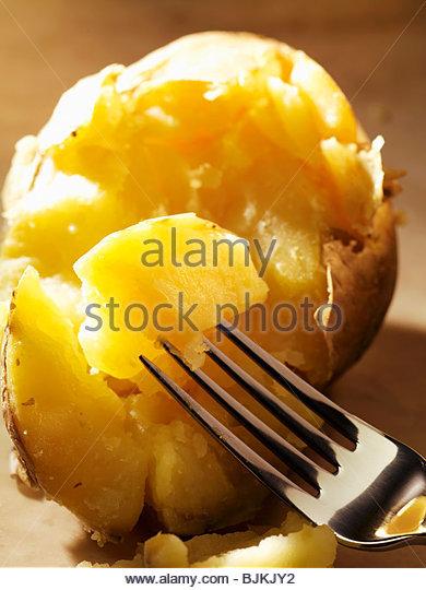 Baked potato with fork (close-up) - Stock-Bilder