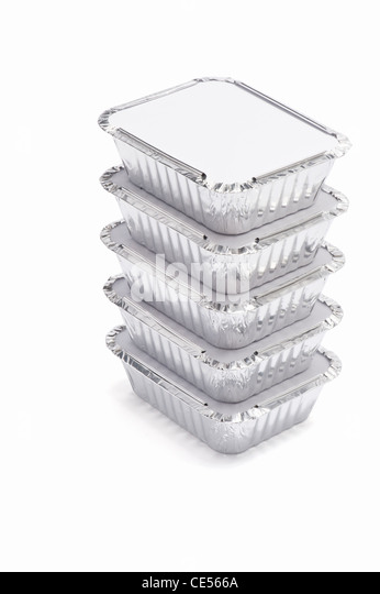 A stack of foil food containers - Stock Image