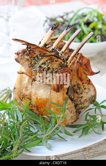 Roast loin of lamb with savory - Stock Image