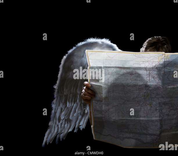 Angel looking at map - Stock Image