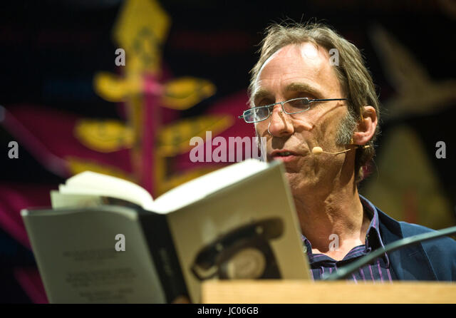 Will Self novelist reading from his novel Phone on stage at lectern during Hay Festival 2017 Hay-on-Wye Powys Wales - Stock Image