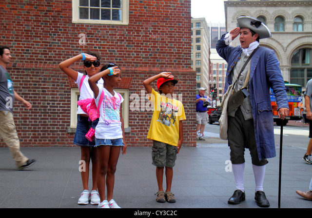 Boston Massachusetts Washington Street The Freedom Trail Old State House historic building costumed re-enactor actor - Stock Image