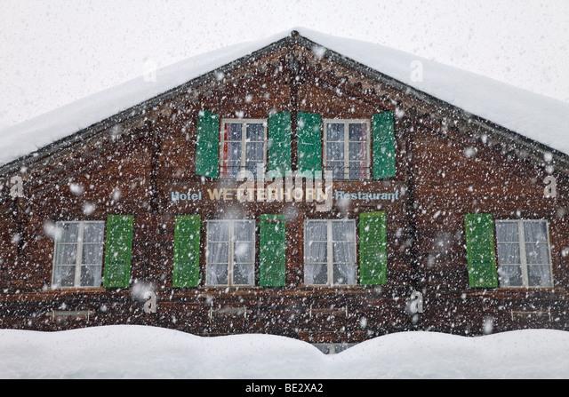 Mountain restaurant in the snow, Grindelwald, Jungfrau region, Bernese Oberland, Swiss Alps, Switzerland - Stock Image